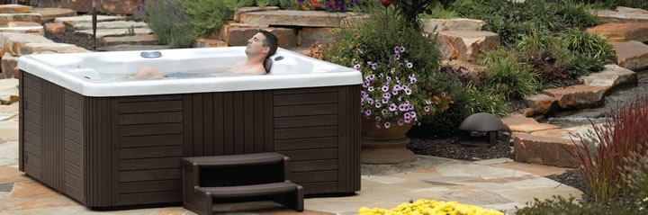 clarity spas 2013 relaxed man in hot tub